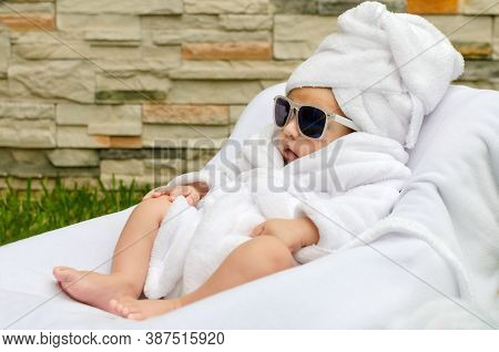 Newborn Baby In Spa Session, Relaxed And Enjoying Wrapped In Towels.