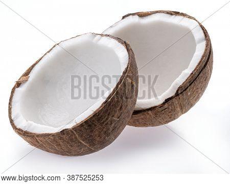 Split coconut fruit with white sweet flesh isolated on white background.