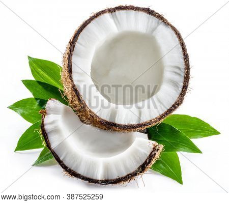 Cracked coconut fruit with white flesh and a piece of coconut isolated on white background.