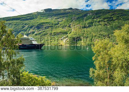 Geiranger, Norway - July 9, 2018: The Cruise Ship Mein Schiff 4 On Fjord Geirangerfjord In Norwegian