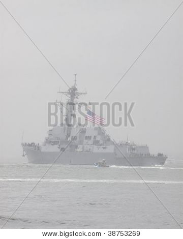 NEW YORK - OCT 9: USS Michael Murphy (DDG 112) departing New York Harbor in rain and fog after being commissioned in New York on October 9, 2012. Lt Murphy was a Navy SEAL who was killed in combat.