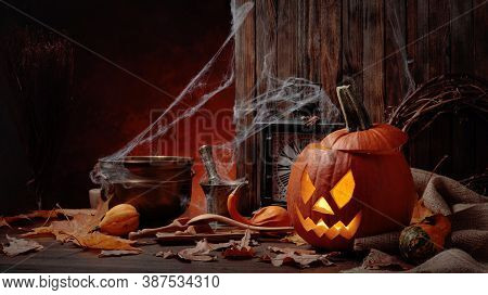 Halloween Pumpkins On A Old Wooden Background. Conceptual Still Life On The Theme Of Halloween. Copy