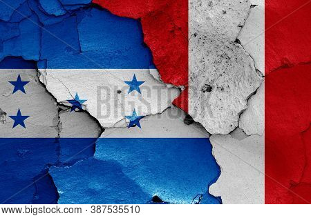 Flags Of Honduras And Peru Painted On Cracked Wall