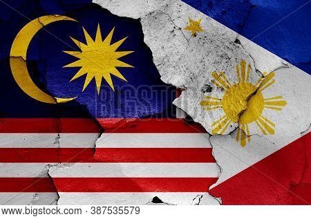 Flags Of Malaysia And Philippines Painted On Cracked Wall
