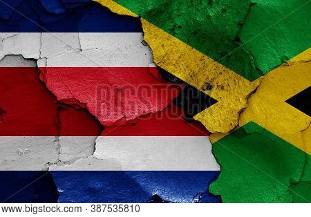Flags Of Costa Rica And Jamaica Painted On Cracked Wall