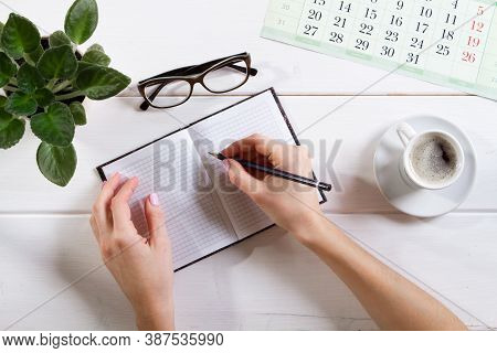 Mockup For Check List, Female Hands Are Writing In A Notebook. On Light Background. Office, Writer O