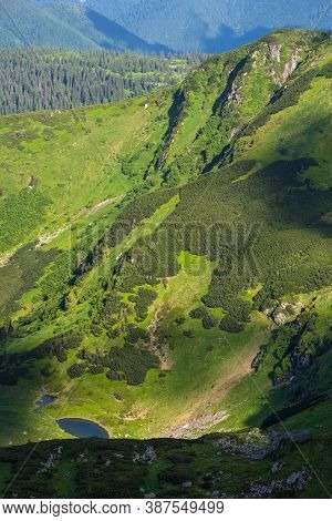 Summer Mountain Landscape With Small Lake In Far. View From Marmaros Pip Ivan Mountain, Carpathian,
