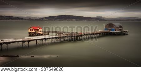 High Tide At Mumbles Pier In Swansea, South Wales Uk, Showing Mumbles Pier And Kilvey Hill.