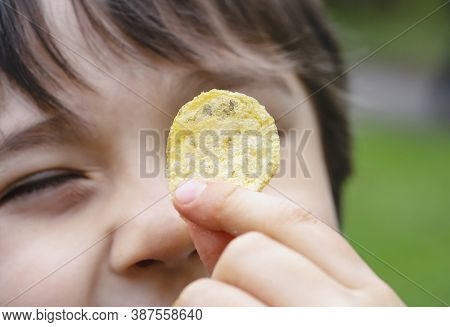 Cropped Shot Kid Showing Potato Chips, Selective Focus Face Of Happy Boy Looking At Fired Potato, Cl