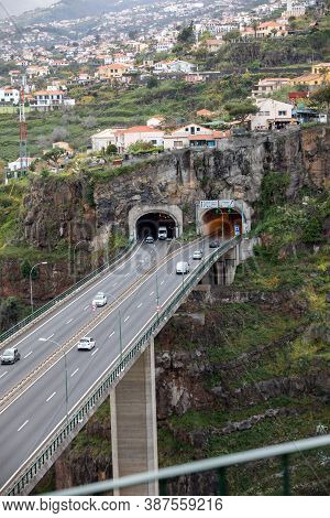 Funchal, Madeira, Portugal - April 23, 2018: Tunnel With A Panorama Of The City Of Funchal In The Ba