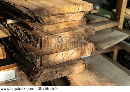 Air-drying Sawn Wooden Plank Slab Pile Under Canopy At Home Backyard Prepared For Carpentry Diy Hobb