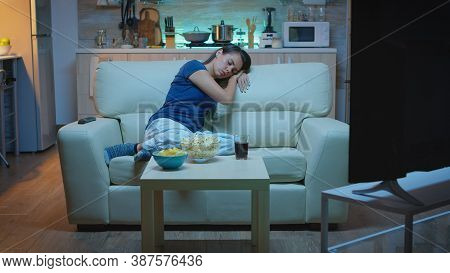 Housewife Falling Asleep In Living Room On Sofa In Front Of Tv. Tired Exhausted Lonely Sleepy Lady I
