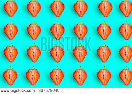 Sliced Strawberry Pattern On Bright Blue Background, Minimal Concept, Copy Space For The Text