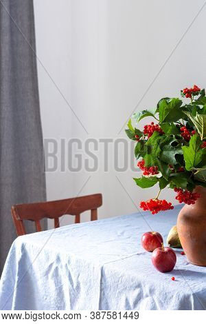 Home Interior, Table With Blue Tablecloth, Clay Vase With Viburnum And Fruits