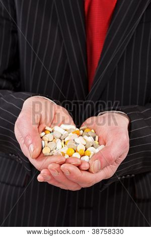 man holding pills