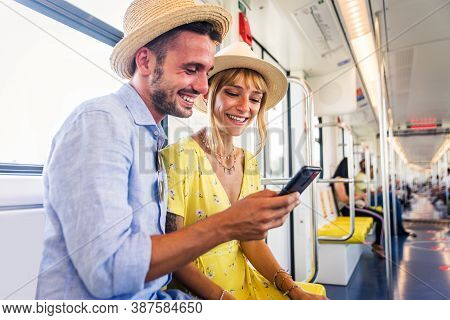 Couple Travelling In The Subway