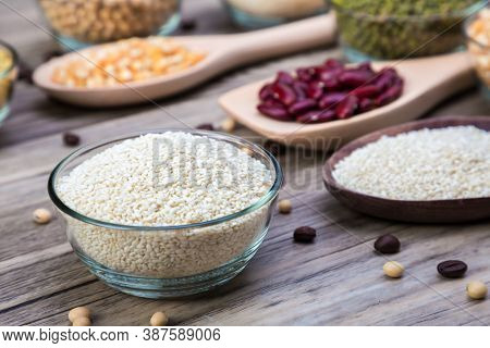 White Sesame In Bowl On Wood Table Background. White Sesame  Seed In Bowls.