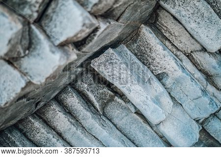 Natural Stone Texture. Basalt Lava Formations Like Columns. Icelandic Typical Natural Background. Vo