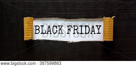 The Words 'black Friday' Appearing Behind Torn Black Paper. Beautiful Background. Business Concept.