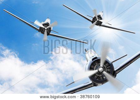 Vintage planes on a sunny sky. Retro technology background.