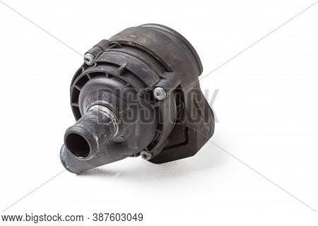 Heating System Valve Made Of Black Plastic On A White Isolated Background In A Photo Studio. A Unit