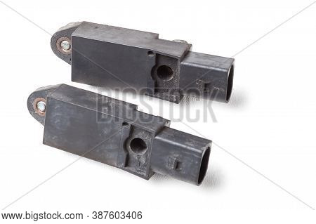 The Spare Part On A White Isolated Background Is An Impact Sensor When Airbags Are Deployed In A Bla