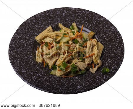 Salad With Soy Asparagus And Carrots, Cucumbers And Dumplings On Brown Plate. Vegetarian Soy Salad O