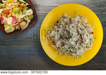 Salad Daikon, Onions And Dill On Blue Grey Wooden Background. Salad On Yellow Plate With Vegetarian