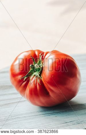 A Red Homegrown Tomato On A Daylight