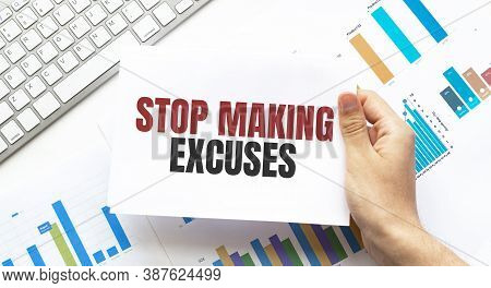 Businessman Holding A Card With Text Stop Making Excuses. Keyboard, Diagram And White Background