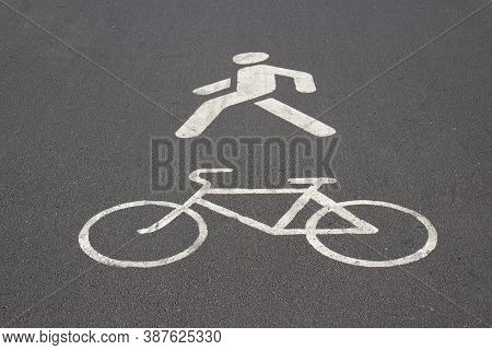 White Road Markings On Pavement. Signs Of Pedestrian And Bike On The Asphalt. Sidewalk For Pedestria