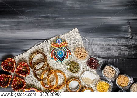 Happy Diwali Greeting Card Made Using Sweets, Or Fire Crackers Or Diya Or Flowers, Selective Focus.