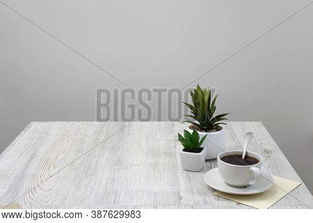 Office Desk Wood Table Of Business Work Place, Artificial Plants And Coffee Cup With Copy Space On G