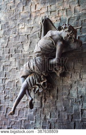 Orvieto, Italy - August 22 2020: Bronze Cherub Angel Figure With Wings, A Door Handle Or Knob On The