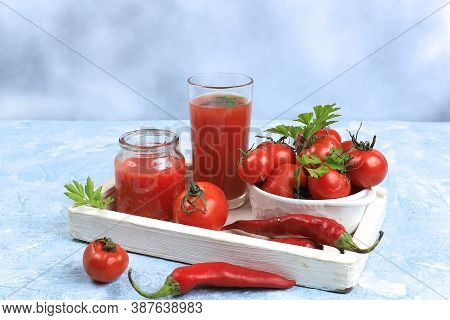 Tomato Juice, Sauce, Pasta And Ingredients On A Specific Table. Detox Diet And Weight Loss Concept,