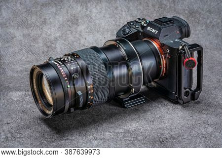 Fort Collins, CO, USA - September 29, 2020: Combining old and new photography technology - vintage Carl Zeiss Hasselblad lens, Fotodiox adapter and modern, digital, mirrorless Sony A7R3 camera.