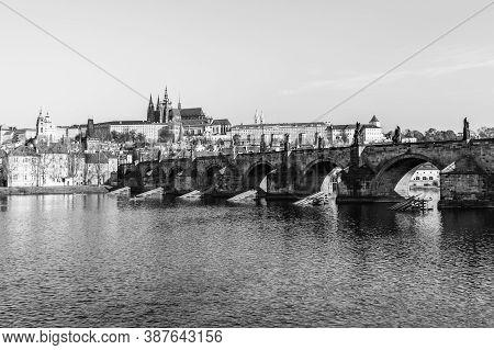 Panoramic View Of Prague Castle And Charles Bridge On Sunny Spring Morning, Praha, Czech Republic. B