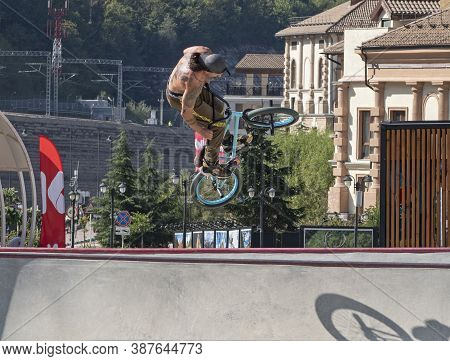 Sochi, Russia - September 27, 2020: Young Active Man Jumping On Bmx Bike In Skate Park