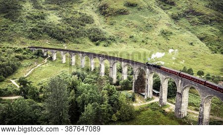 Aerial Photo Of Famous Steam Train On Glenfinnan Viaduct