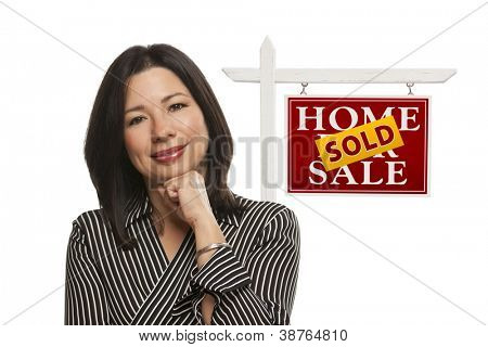 Ethnic Woman in Front of Sold Home For Sale Real Estate Sign Isolated on a White Background.