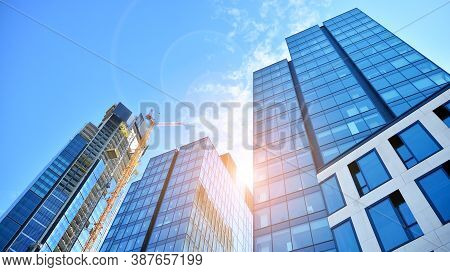 High-rise Building Under Construction. Modern Office Building. Sunset.