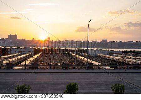 Subway Trains Outside In Midtown Manhattan West Side And View On New Jersey. Beautiful Sunset