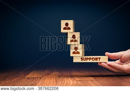 Customer Care And Support Balance Concept. Hand Of Manager Balancing Cubes With Icons Of Customers,