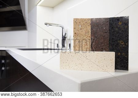 Different Quartz Kitchen Counter Top Samples On White Polished Countertop With Precise Processed Edg