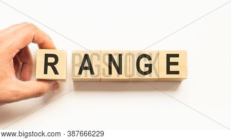 Word Range. Wooden Small Cubes With Letters Isolated On White Background With Copy Space Available.b