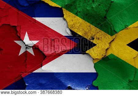 Flags Of Cuba And Jamaica Painted On Cracked Wall