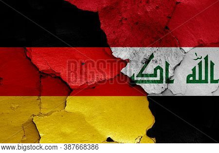 Flags Of Germany And Iraq Painted On Cracked Wall