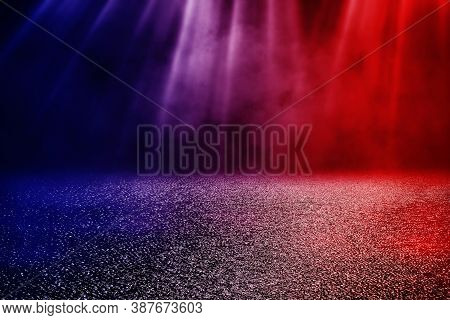 Abstract Image Of Empty Wet Asphalt Road With Red And Blue Lighting Effect And Fog Or Mist In Backgr