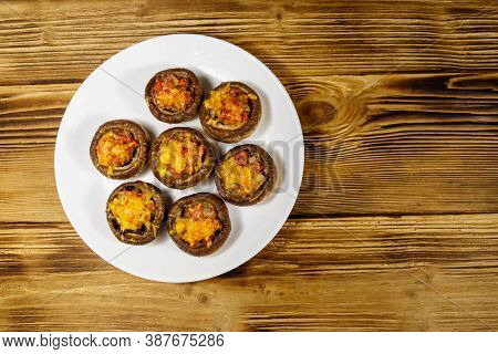 Baked Mushrooms Stuffed With Minced Meat, Mushroom, Paprika, Onion And Cheese On Wooden Table. Top V