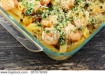 Shrimp Rigatoni Pasta Casserole In A Cream Sauce With Parsley And Panko Breadcrumbs In Glass Baking